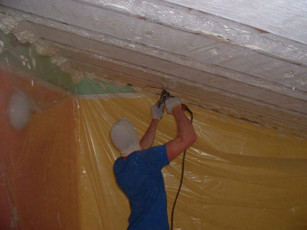 Open cell insulation foam is trimmed overhead.