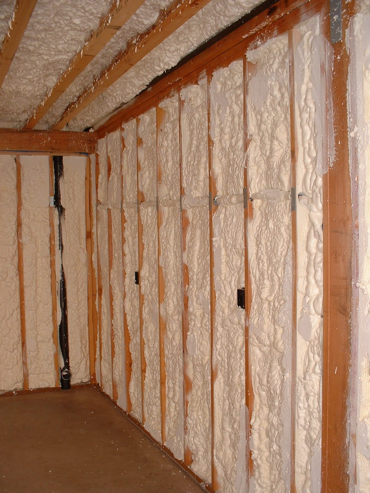 Spray Foam Insulation visible during a basement upgrade