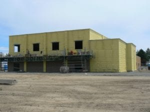 Icyene used on exterior of school for vapor barrier. Exterior of the building is yellow.