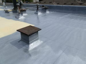 A coating applied over foam roof.