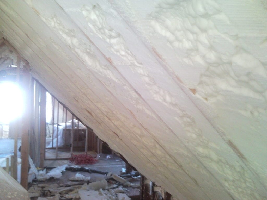 Trimmed spray foam attic insulation