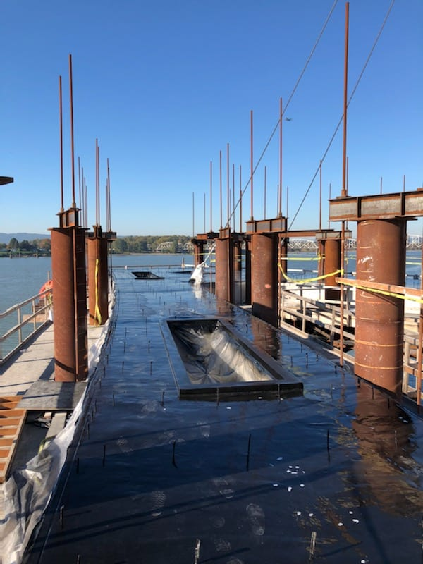 Polyurea applied to Grant Street Pier in Vancouver to protect concrete coloring from water discoloration.