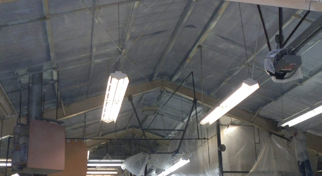 Spray foam installation on a warehouse ceiling